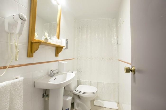Chambres avec salle de bains attenante et service de blanchisserie